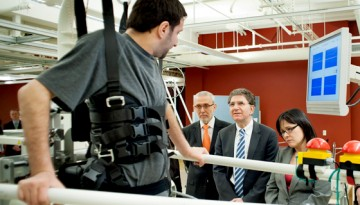 L-R: Mustafa Hasan, a research participant, demonstrates the body weight supported treadmill for Andrei Krassioukov, Professor in the Division of Physical Medicine and Rehabilitation; Howard Feldman, Executive Associate Dean, Research; and Minister of Health Leona Aglukkaq. Photo: Martin Dee
