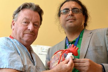 Inventors and UBC researchers Guy Fradet (left) and Hadi Mohammadi hold up their synthetic heart tissue.