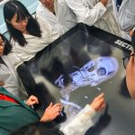 Students learn about internal anatomy while viewing 3-D images on the anatomy visualization table.