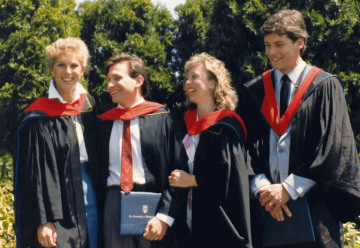 Dr. Peter Jepson-Young (second from left) and Dr. Deborah Money, Executive Vice Dean for the UBC Faculty of Medicine, (second from right) celebrate their graduation from UBC medical school. (Courtesy Dr. Peter AIDS Foundation)